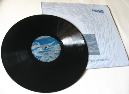 Tortoise  - Millions  Now Living Will Never Die vinyl - Side 1 and cover.  Photo by Hans Morgenstern.