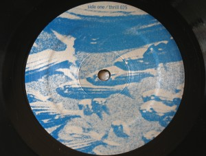 Tortoise  - Millions  Now Living Will Never Die vinyl - Side 1 label.  Photo by Hans Morgenstern.