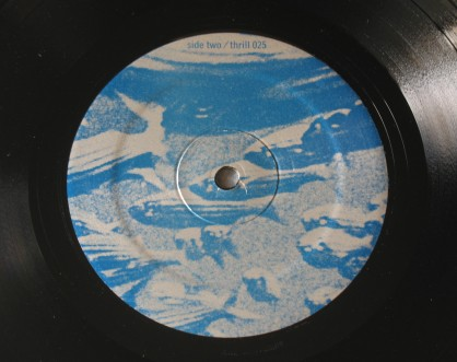 Tortoise  - Millions  Now Living Will Never Die vinyl - Side 2 label.  Photo by Hans Morgenstern.