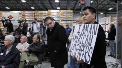Jose attends a Mitt Romney presidential campaign rally in Cedar Rapids