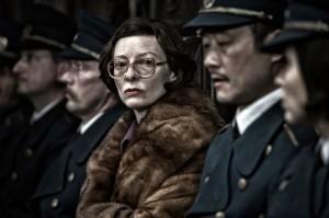 Tilda Swinton and officers in Snowpiercer